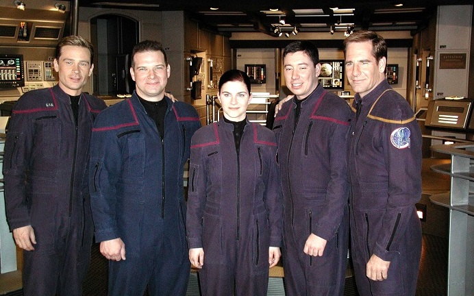 Connor Trinneer (pictured far left) and Scott Bakula (pictured far right) in costume alongside three members of the crew of the aircraft carrier USS Enterprise (CVN-65).